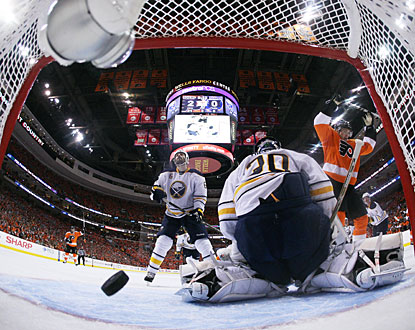 Danny Briere (right) puts the puck past Ryan Miller for his series-leading sixth goal. (Getty Images)