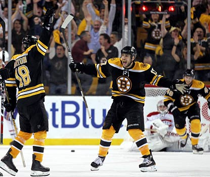 Milan Lucic comes to Nathan Horton (left) to start the celebration as Boston moves on to meet Philly.  (Getty Images)