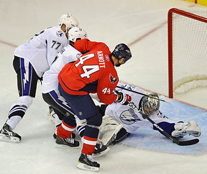 Tampa Bay goaltender Dwayne Roloson makes one of his 26 saves during the Lightning's 4-2 win. (US Presswire)