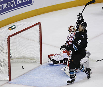 San Jose's Joe Pavelski scores against Detroit's Jimmy Howard in Game 1. (AP)