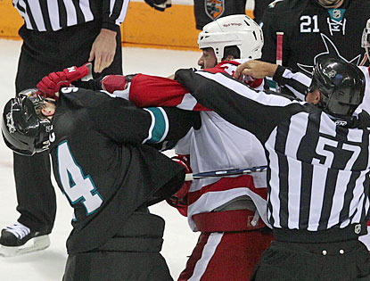 Marc-Edouard Vlasic (left) and Todd Bertuzzi draw roughing penalties in the first period. (AP)