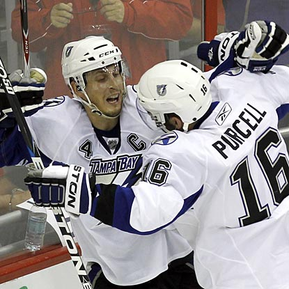 Vincent Lecavalier's second goal of the game comes in overtime, giving the Lightning a surprising 2-0 series lead.  (AP)