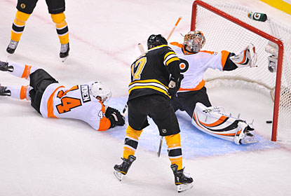 It takes two rounds, but Milan Lucic finally gets his first goals in this year's postseason, putting two past Sergei Bobrovsky. (Getty Images)