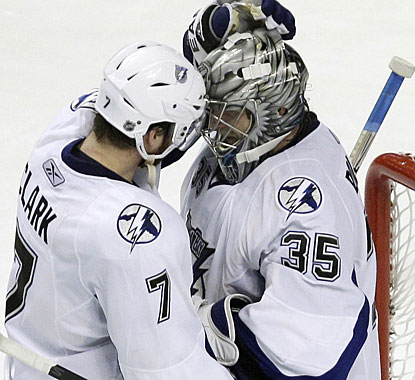 Brett Clark, who scores one of Tampa's goals, congratulates Dwayne Roloson for his 31-save effort in net. (AP)