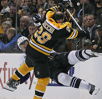 Mark Recchi gets a busted lip and lots of cheers from the Boston faithful after this huge collision with Mattias Ohlund. (AP)