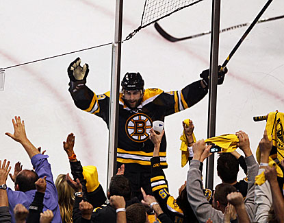 Boston's Rich Peverley celebrates his third-period goal against the Lightning with the Bruins fans. (Getty Images)