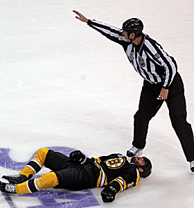 Boston's Nathan Horton lays on the ice after the hard body check by Aaron Rome. (AP)