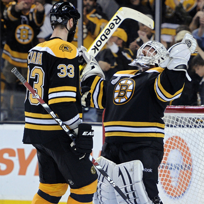 Tim Thomas (right) celebrates a Game 6 victory with Zdeno Chara after stopping 36 of 38 shots.  (Getty Images)