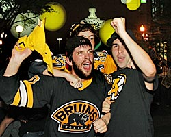 Fans celebrate in Boston after the Bruins' Stanley Cup triumph. (AP)