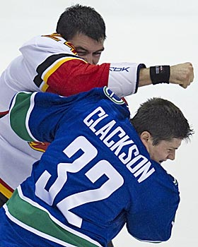 The NHL is punishing goons like the Flames' Pierre-Luc Letourneau-Leblond (left) for dirty hits by taking away games. (AP)