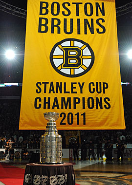 The Boston Bruins present fans their first Stanley Cup banner since 1972. (Getty Images)