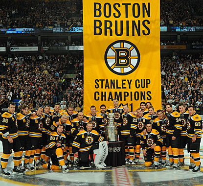 The Bruins pose with the Stanley Cup and their championship banner before losing to the Flyers. (Getty Images)