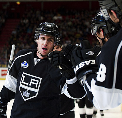 Mike Richards is greeted by high-fives after he scores in the Kings' season opener against the Rangers in Stockholm. (Getty Images)