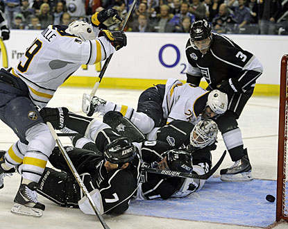 The Kings' defensive core is unable to prevent the puck from going in for one of Luke Adam's (not pictured) goals. (AP)