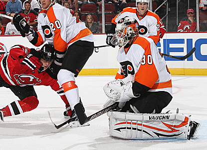 Goalie Ilya Bryzgalov (30) makes a chest save against Nick Palmieri (12) of the New Jersey Devils in a shutout effort. (Getty Images)