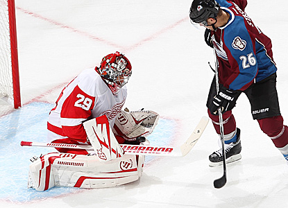 Goaltender Ty Conklin (29) makes a save against Paul Stastny (26) of the Avs.  Conklin turns away 29 shots in the shutout. (Getty Images)