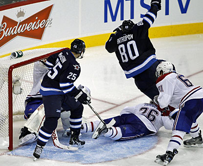 Nik Antropov (80) scores the first goal for the new Winnipeg Jets at 2:27 of the third period. (AP)