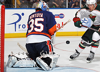 Al Montoya sends back one of his 20 saves on the night to help the Islanders win 2-1 versus the Wild. (Getty Images)