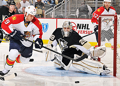 Marc-Andre Fleury defends the net against the Panthers.  He turns away 32 shots on the night. (Getty Images)