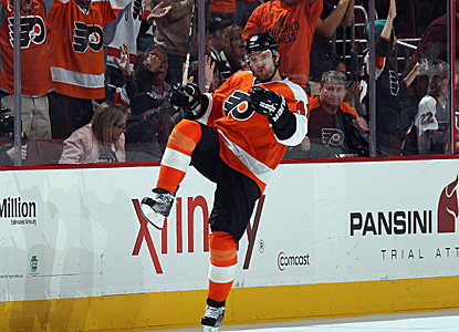 Andrej Meszaros celebrates after scoring the game-winning goal in a 5-4 victory for the Flyers in their home opener. (Getty Images)