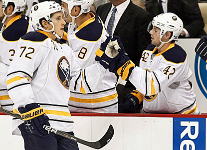 The Sabres' Nathan Gerbe (right) celebrates with Luke Adam after scoring against the Penguins. (Getty Images)
