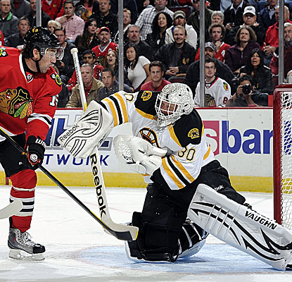 Goalie Tim Thomas allows two scores by the Blackhawks, but makes 27 saves in Boston's road win. (Getty Images)