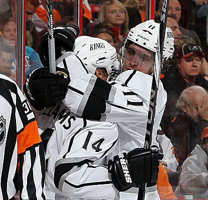 Justin Williams (No. 14) celebrates his third-period goal with teammates as the Kings get the win. (Getty Images)