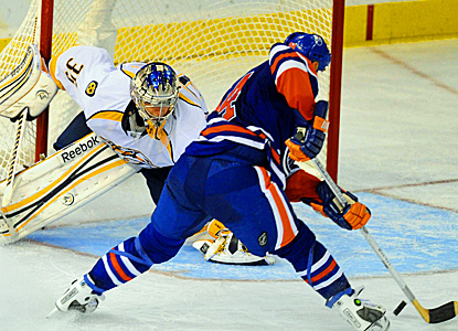 Ryan Smyth scores the winning goal against Predators goalie Pekka Rinne with 12:29 remaining.  (AP)
