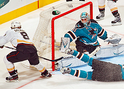 Teemu Selanne of the Ducks scores one of his two first-period goals against the Sharks. (AP)