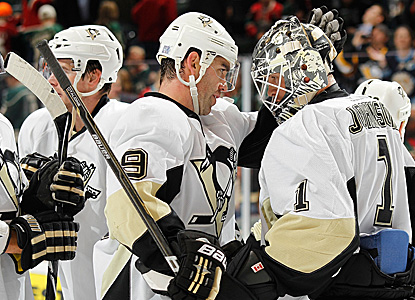 Pascal Dupuis (#9) celebrates with his depleted team after beating the Wild. (Getty Images)