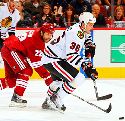 Chicago's Dave Bolland defends the puck against the Coyotes, scoring one goal and one assist. (Getty Images)