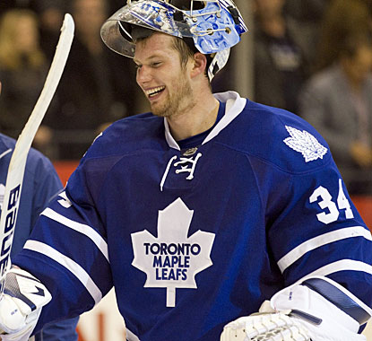 Goaltender James Reimer has good reason to smile after making sure Toronto gets both points in the shootout. (AP)