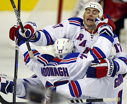 Brandon Dubinsky jumps for joy with Ryan McDonagh, who gives New York the dramatic win. (AP)