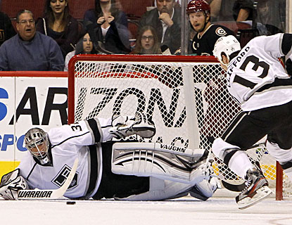 Jonathan Quick makes a save on Coyotes captain Shane Doan (behind net) to preserve the shutout. (AP)