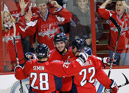 The Capitals and fans alike celebrate Marcus Johansson's (center) goal, which makes it 2-0 Washington. (AP)