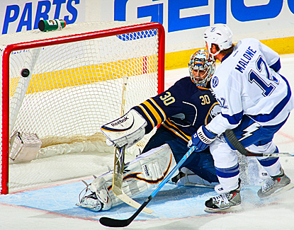 The Lightning's Ryan Malone shoots the game-winning goal against the Sabres' Ryan Miller in the third period.  (Getty Images)