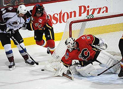 Goalie Miikka Kiprusoff sends back 34 shots on the night to keep the visiting Avs one short of their record road win streak. (Getty Images)