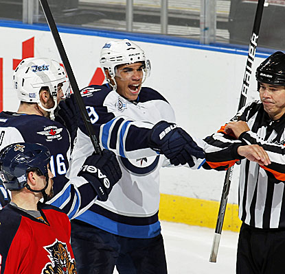 Winnipeg's Evander Kane (center) celebrates after scoring a goal to tie the game in the third period. (Getty Images)