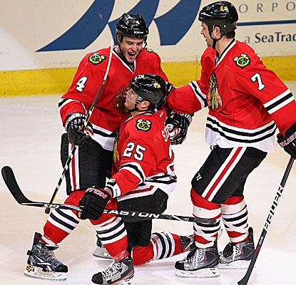 Chicago's Viktor Stalberg (center) celebrates his OT game-winning goal on Nashville goalie Pekke Rinne. (Getty Images)