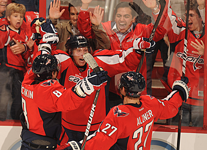 Nicklas Backstrom (center) celebrates with teammates after scoring in overtime, his second goal on the night.  (Getty Images)