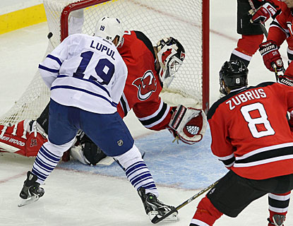 Joffrey Lupul welcomes Martin Brodeur back to action in a rude manner -- scoring three goals in 7:22 in the second period. (US Presswire)