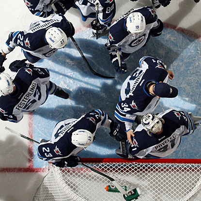 After stopping everything thrown his way, Ondrej Pavelec gets appreciation from his teammates. (Getty Images)
