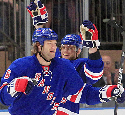 Jeff Woywitka (6) celebrates his first Rangers goal with Marian Gaborik, who later nets the winner in the shootout. (AP)
