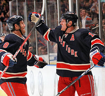 Brad Richards (right) celebrates his goal late in the second period with Brandon Prust. (Getty Images)