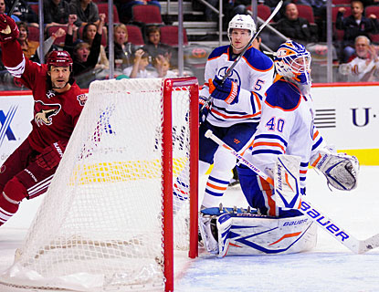 Daymond Langkow enjoys his goal as Ladislav Smid and goalie Devan Dubnyk are dejected. (US Presswire)