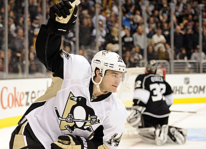 Chris Kunitz scores the tying goal and later adds the deciding tally to lead the Penguins to victory in a shootout. (Getty Images)