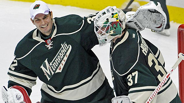 Niklas Backstrom (left) congratulates his fellow goalie after Josh Harding shut out the Wings 1-0. (AP)