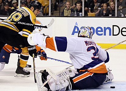 Nathan Horton scores two goals and adds an assist to help the defending champs rout the Islanders. (Getty Images)