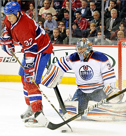 Nikolai Khabibulin's stellar first month of the season continues with a 28-save victory in Montreal.  (Getty Images)