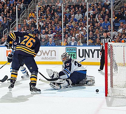 Thomas Vanek's power-play goal late in overtime gives Buffalo and goalie Ryan Miller a much-needed victory.  (Getty Images)